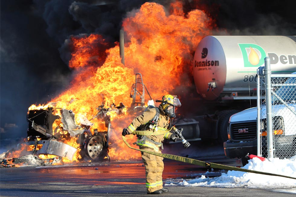 Fire fighters Tending to a semi truck fire