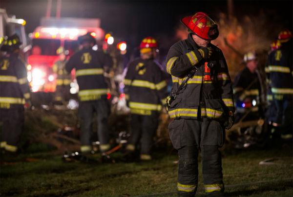 Fire fighter deciding if he needs help