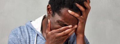 Man affected by his PTSD internal trigger, sadness.