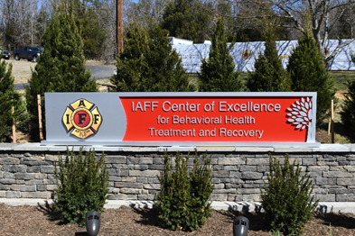 Entrance sign for the IAFF Center of Excellence