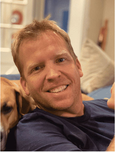Photo of NC Local 947 peer support instructor Justin Price with a dog