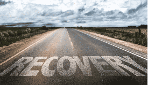 An open road with the word recovery painted on it