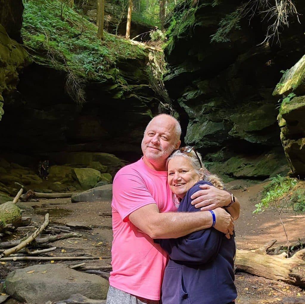 skip ockomon hugging his wife